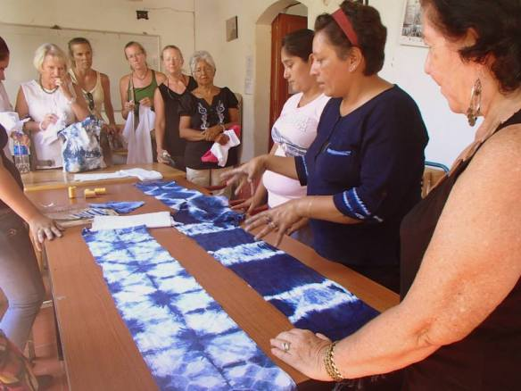 Learning about indigo tie dying from women's artist coop