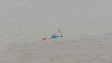 One man kayak making his way down the Guayas River