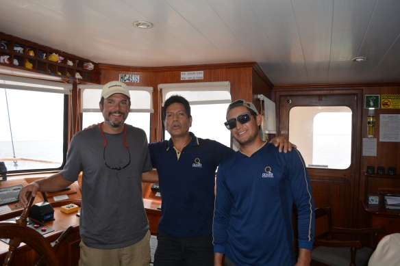 Capt Pete with Evolution's Captain Victor and first mate David