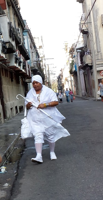 Initiates in the Santería religion are required to wear white clothing for a year, and they always carry a white umbrella.