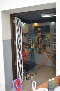 Artist working in his studio.