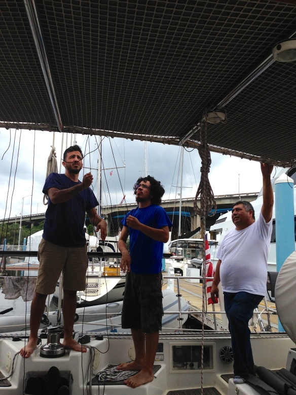 Mauricio and his guys were masters at their craft.  Here they are installing our new grey bimini.