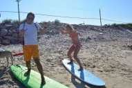 Sophie giving Pete a surfing lesson . Block Island