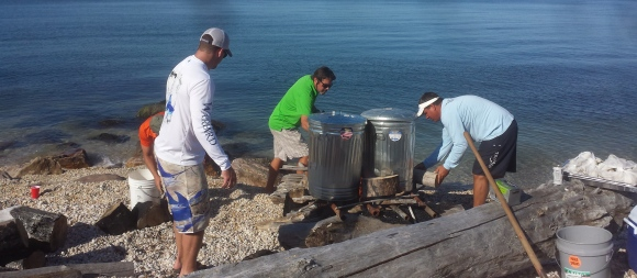 Pete and John build the fire for the clam/lobster bake