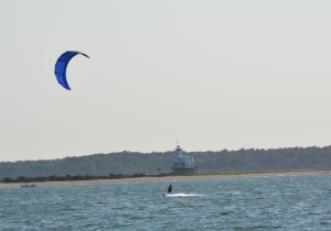 Pete kiting by Bug Light lighthouse in Orient