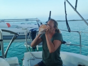 Our friends on R&R taught Mary the art of playing a conch. Tradition to blow at sunset.