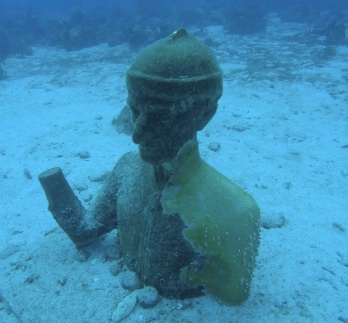 Underwater statue of Jacques Cousteau at the Cousteau underwater reserve.