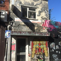 If you can't beat them, join them. This landlord welcomes the artists to use his walls as their canvas.
