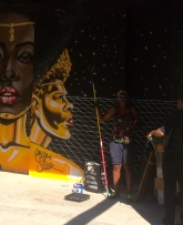 artist working on her mural.
