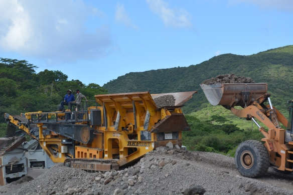 breaking up large volcanic rocks to produce and sell cement.